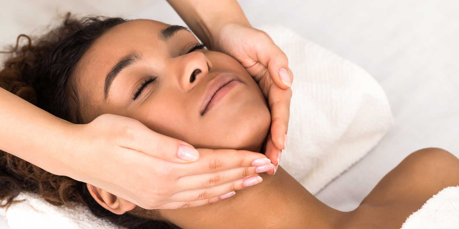 Lady getting a facial massage
