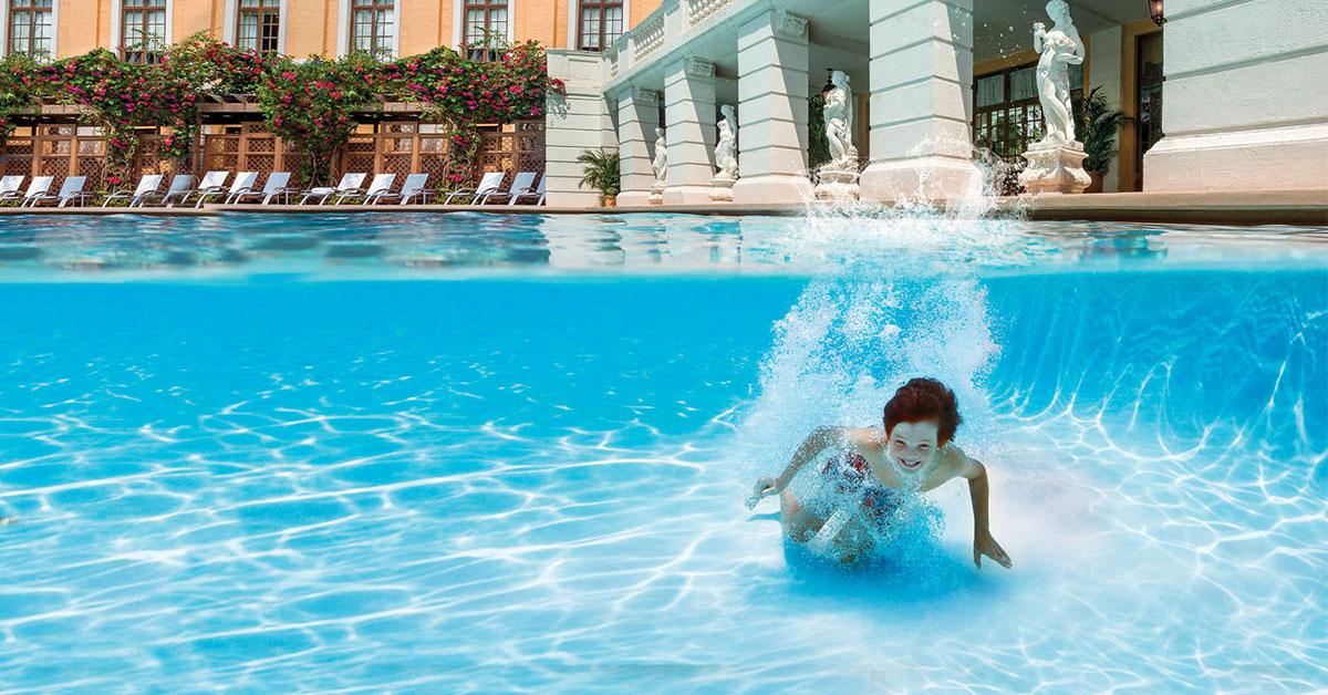 Boy having summer fun swimming in the Biltmore Pool